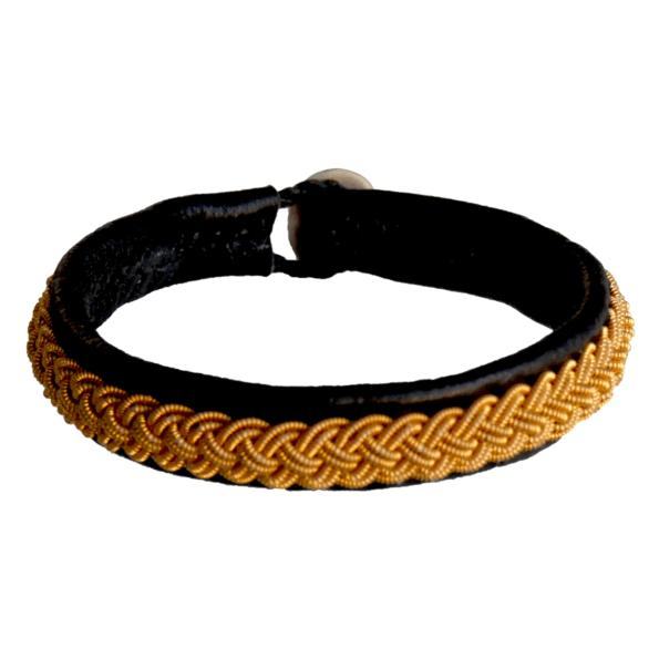 Empreinte Nomade, bracelet Lapon Saimi Coloris Noir tresse Or - cassisroyal.com